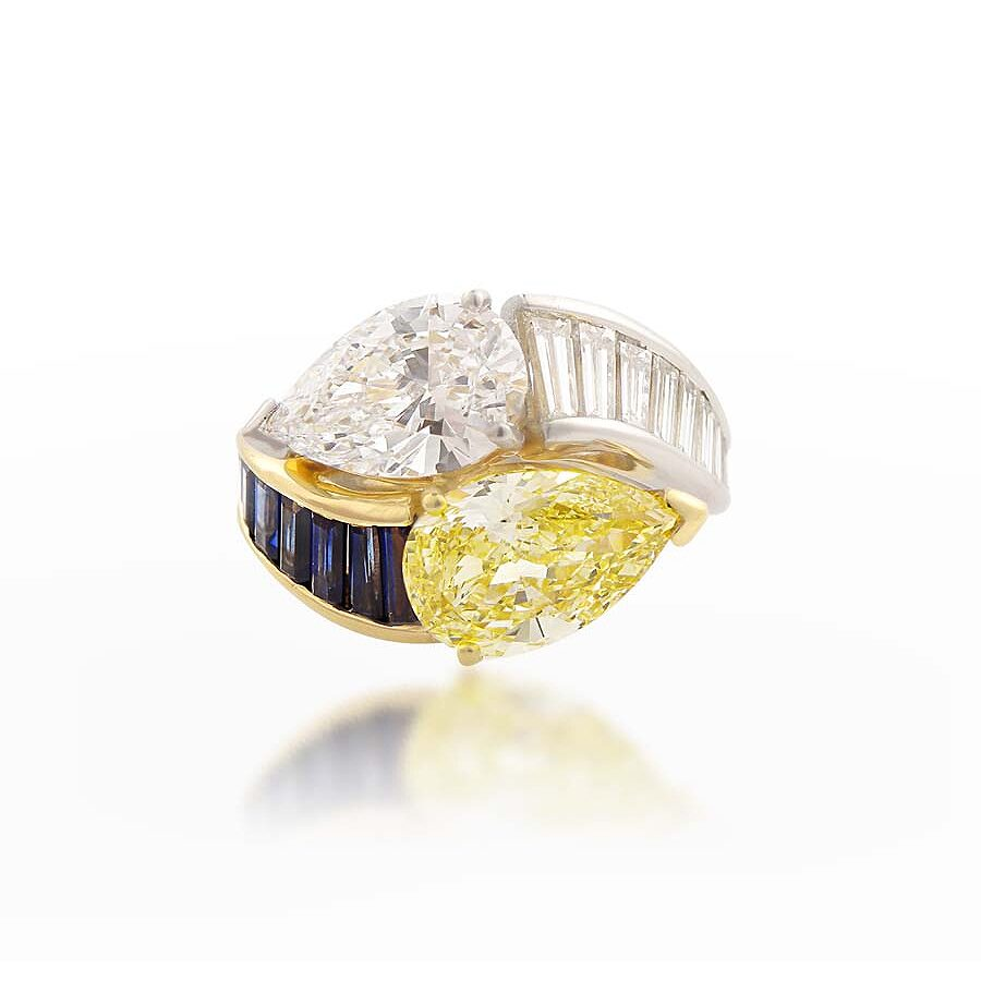 Stunning Pear Shaped Diamond Ring with White Diamond and Sapphire Baguettes 6.47 CT